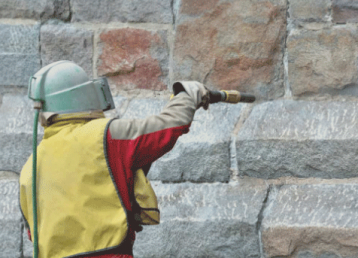 soda-blasting-miami florida-a-concrete-wall-with-suit